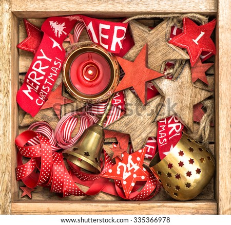 Christmas box decorations wooden stars, red ribbons and burning candle. Vintage style colored picture. Merry Christmas! - stock photo