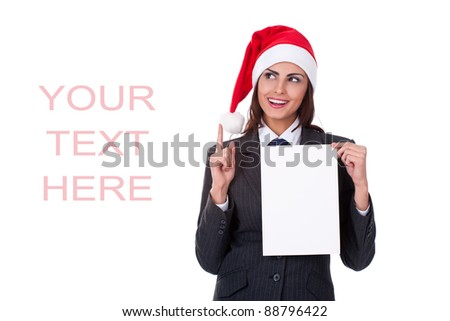Christmas businesswoman in santa hat with blank billboard on white background