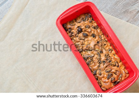 Christmas cake on the baking paper, top view - stock photo