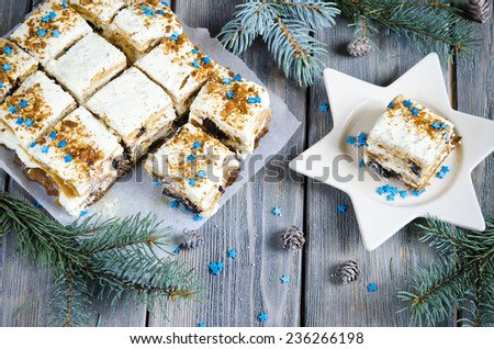 Christmas cake with a Christmas decoration on the wooden background - stock photo