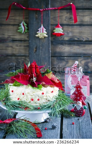 Christmas cake with a Christmas decoration on the wooden background