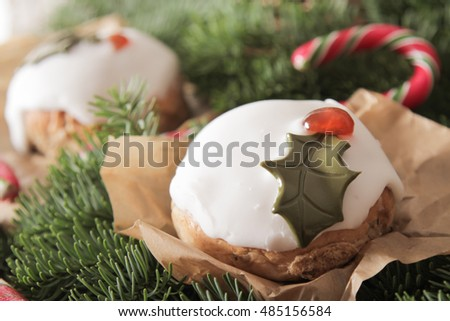 Christmas cake with homemade caramel cane on the background of trees