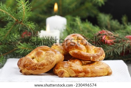 Christmas cakes and fir branches in the background - stock photo