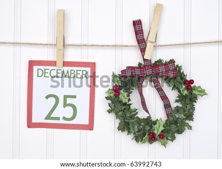 Christmas Calendar Page is the Focus of this Holiday Concept Image. - stock photo