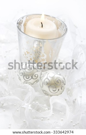 Christmas candle and baubles - stock photo