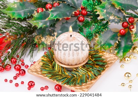 Christmas candle and decoration on gray background. - stock photo