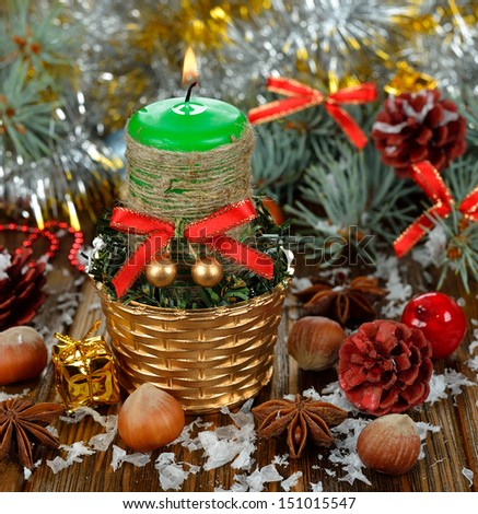 Christmas candle and decorations on a brown background