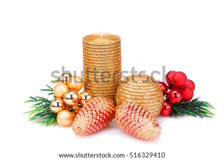 Christmas candle, balls and  fir tree branches isolated on white background.