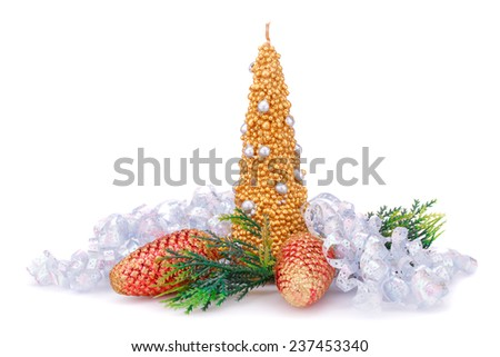 Christmas candle, cones and gray ribbon  isolated on white background. - stock photo