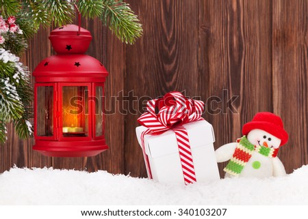 Christmas candle lantern, gift box and snowman toy