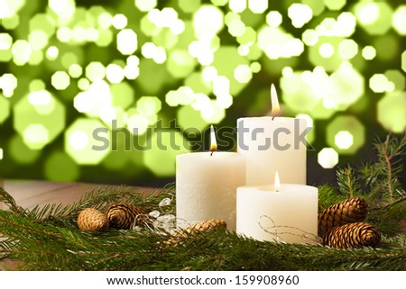 Christmas Candle Setting with Bokeh Background - stock photo