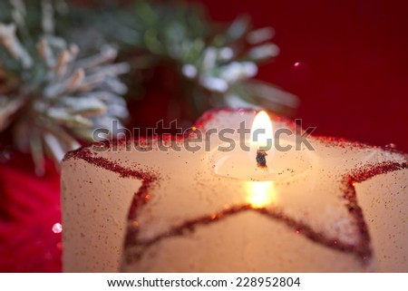 Christmas candle star in red closeup - stock photo
