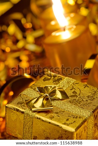 Christmas candles and gift boxes. Gold color - stock photo