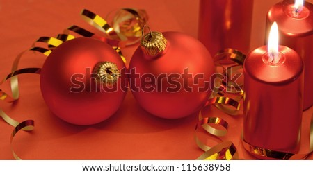 Christmas candles and red spheres. A celebratory composition - stock photo