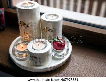 Christmas candles at window