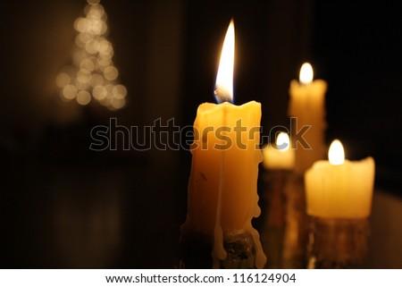 Christmas candles, Christmas lights - stock photo