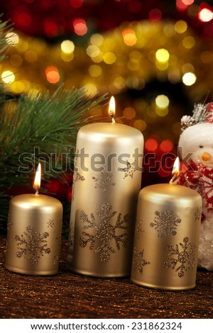 christmas candles in atmospheric light - stock photo