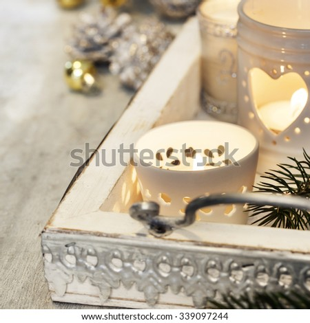 Christmas candles on wooden background. Christmas background - stock photo