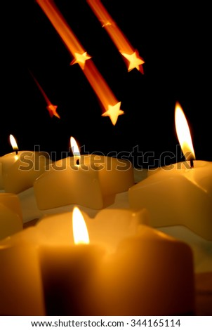 Christmas candles over black background - stock photo