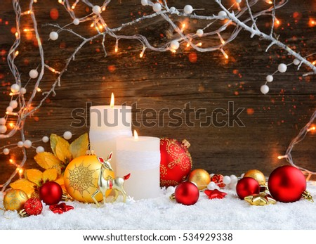 Christmas candles with Christmas ornaments and Christmas lights. Festive Christmas background
