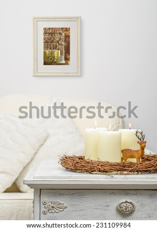 Christmas candles with reindeer decoration - stock photo