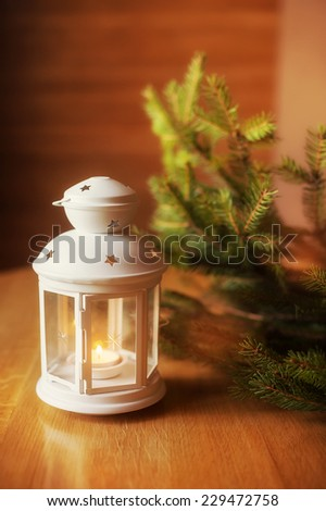 Christmas candlestick on a wooden table.