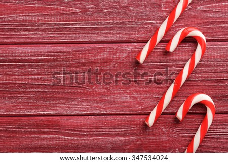 Christmas candy can on a red wooden table - stock photo