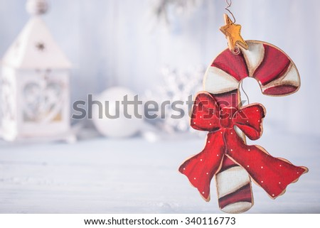Christmas candy cane decoration and other at left top corner of light blue background with copy space