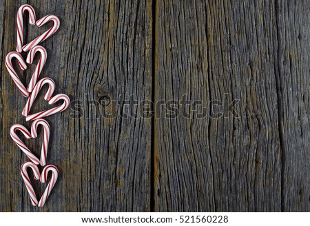 Christmas candy cane heart border on rustic barn wood
