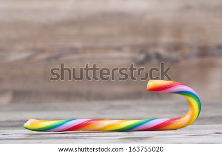 Christmas candy cane on wood texture - stock photo