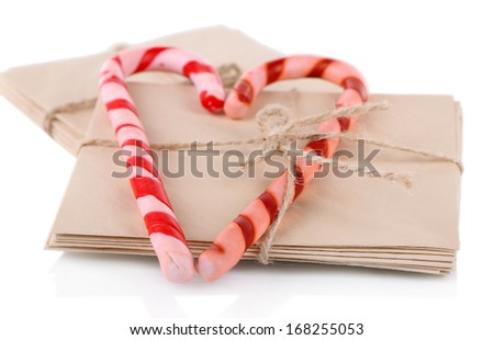 Christmas candy canes and letters for Santa, isolated on white