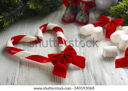 Christmas Candy Canes on table close-up - stock photo