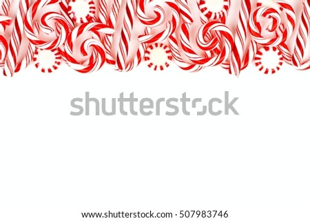 Christmas Candy Top Border With Peppermints And Canes Over A White Background