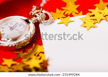 Christmas card. Beautiful background with a clock and decorations. macro - stock photo
