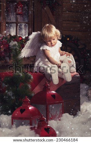 Christmas card. Christmas cute infant angel. Beautiful little girl dressed as an angel.  - stock photo