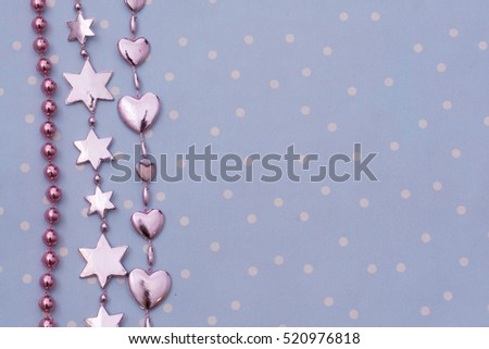 Christmas card. Christmas decoration on a Christmas tree on a blue background (star, heart, beads).