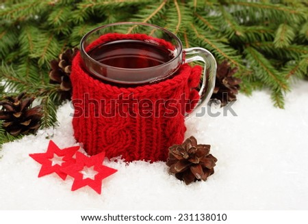 Christmas card. Cup of tea,  Christmas tree branches, cones and felt  decorations - stock photo