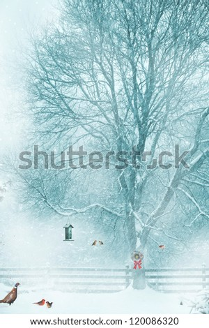 Christmas card design with birds and animals gathering around a bird feeder during a snow storm. - stock photo