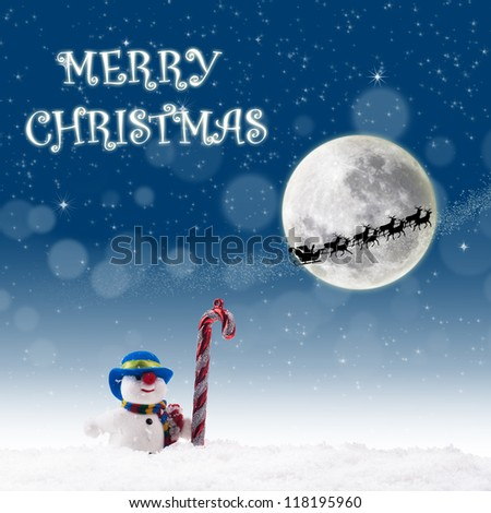 Christmas card design with snowman and candy cane under full moon  on blue background - stock photo