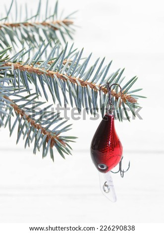 Christmas card for fish man - fir decorated with wobbler, selective focus on the fir - stock photo
