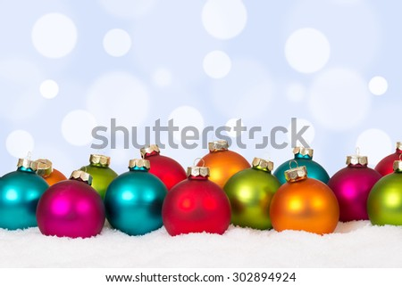 Christmas card many colorful balls decoration with snow and copyspace - stock photo
