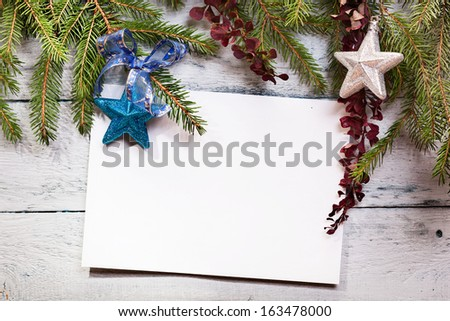 Christmas card on a wooden board  - stock photo