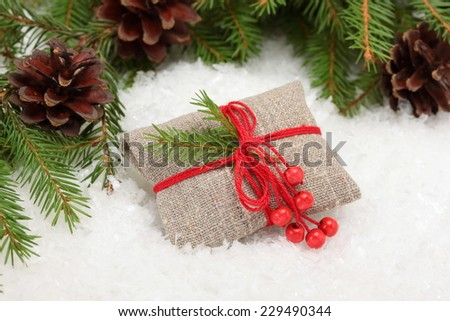 Christmas card. Vintage rural gift and Christmas tree branch on white - stock photo