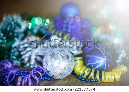 Christmas card with balls and decorations on a dark wooden background