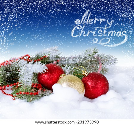 Christmas card with balls and fur tree on the snow  - stock photo