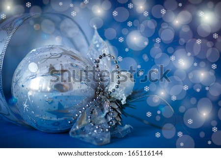 Christmas card with balls and ornaments on a blue background - stock photo