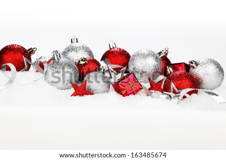 Christmas card with decoration and gifts on snow - stock photo