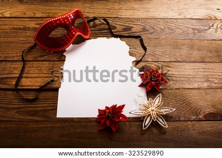 Christmas card with decorative accessories on dark brown wooden background. Selective focus