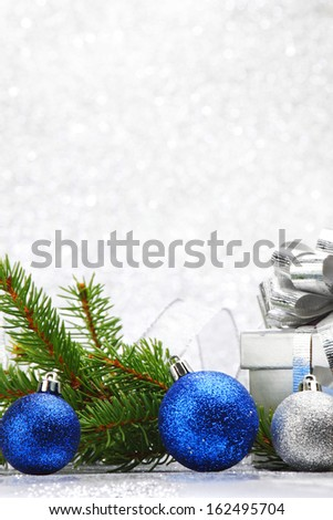 Christmas card with fir branch and colorful decoration