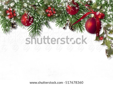 Christmas card with fir branches, balls and holly on a white bac